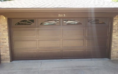 New brown ranch style garage door with colonial inserts