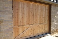 natural wood garage door with no hardware