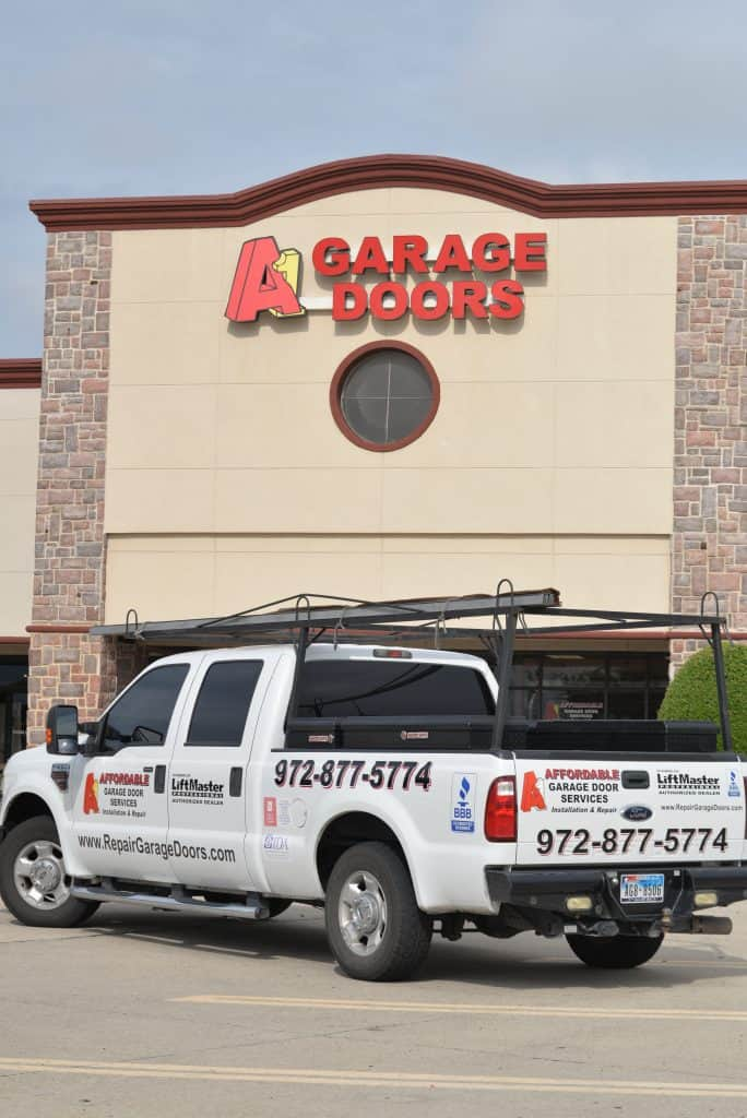 A1 Affordable Garage Door Services with Truck at the Plano Showroom